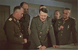 "Discussion of war situation at Führerhauptquartier ""Wolfsschanze"" Rastenburg, Ostpreußen, 11 February 1942. From left to right: Marshal Ion Antonescu, Dr. Paul Otto Schmidt (interpreter), Adolf Hitler, Generalfeldmarschall Wilhelm Keitel (blocked), Oberstleutnant Eckhard Christian, and Generaloberst Franz Halder."